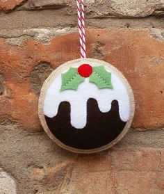 Here is my cute felt Christmas pudding ornament. This has been made with 100% wool felt and has been entirely hand stitched. It measures