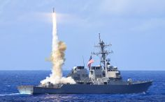 Arleigh Burke-class guided-missile destroyer USS Curtis Wilbur (DDG 54) fires a Standard Missile 2 (SM-2)