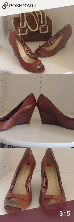 "Saddle Brown Wedge Heels 3 1/2"" wedge heel, peek toe, with small bow, animal print fabric inside. Dark tan, or saddle brown. BCB Generation Shoes Wedges"