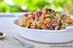 The Whole Life Nutrition Kitchen: Heirloom Tomato Basil Quinoa Salad.  This looks absolutely delicious!