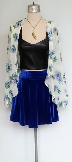 White chiffon kimono style jacket, faux leather crop top and bright royal blue velvet skirt.