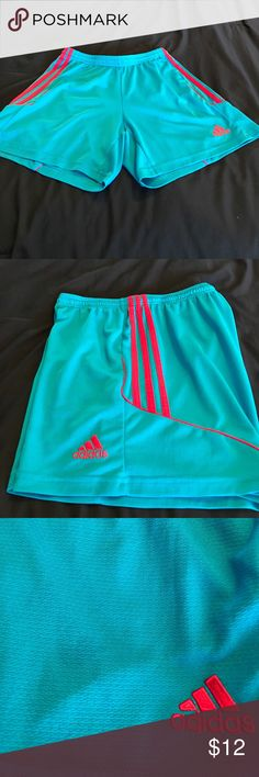 Adidas Running Climalite Running Shorts Bright blue-teal shorts with the classic red Adidas stripes running down the sides. Extremely faint and barely noticeable tiny stain on the right leg. Lightweight and perfect for working out! adidas Shorts