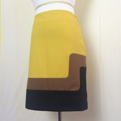 Mod color block skirt Mustard, brown and black color block skirt. Hidden side zip. Soft and stretchy. Like new. Ann Taylor Loft Skirts