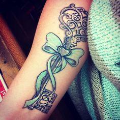 Key Fairytale Baby Blue Ribbon Tattoo Design