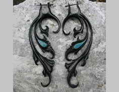Breathless fake gauge earrings - horn black / turquoise. $26.00, via Etsy. would love to wear these through a pair of tunnels.