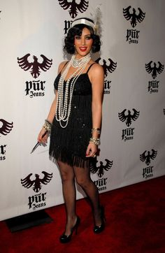 Pin for Later: Double Trouble: Hollywood's Halloween Costume Copycats  Kim Kardashian rocked a '20s-inspired costume in 2008.