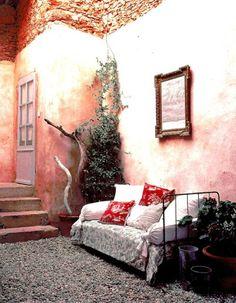 Bohemian day bed, peach walls, courtyard