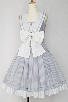 Victorian Maiden - Sheer Check Series. Sheer Check Marine Ribbon Lolita Dress. Lots of ruffles and a big bow on this one. Zipper back and ruched front under the bow (bow is removeable). I wonder if I could replicate something similar?