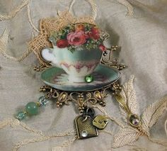 Beautiful Victorian Tea Brooch,love the charms dangling on the ends
