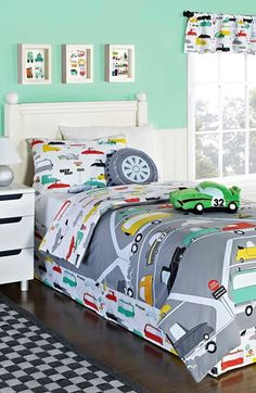 Fun! This road and train print bed set is so cute.