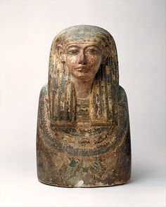 Ancestral Bust, Period: New Kingdom, Ramesside Dynasty: Dynasty 19, early, Date: ca. 1320–1237 B.C., Geography: Possibly from Egypt, Upper Egypt; Thebes, Deir el-Medina, Medium: Painted limestone.-'During the Ramesside Period busts of family ancestors were set into niches in the walls of houses of the village of Deir el Medina, or placed in tombs in the cemeteries there.'