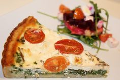 Spinach, feta and cherry-tomato quiche with beet root and orange salad