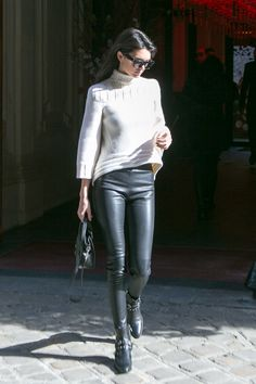 Kendall made a simple black and white outfit look so chic by playing with texture. Her soft white sweater is a chic contrast to her edgy black leather leggings.   - Seventeen.com