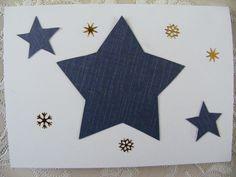 voorkant dubbele witte kaart beplakt met uitgeknipte kerstster en stickers