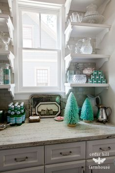 turquoise-christmas-bottle-brush-trees (Cabinet, counter, and backsplash combo that I need.  Also love the style of open shelves.)