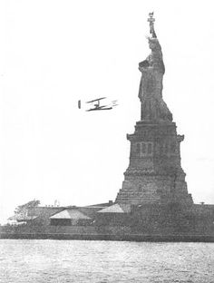 Sept. 29, 1909, Wilbur Wright circles the Statue of Liberty in New York harbor.