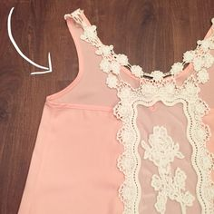Paper Crane Lace Top This pink sleeveless top is beautiful! Exposed back with lace and crocheted detailing. 100% polyester   Need any other information? Measurements? Materials? Feel free to ask! Don't be shy, I always welcome reasonable offers! Fast shipping! Same or next day! Sorry, no trades!  Happy Poshing!☺️ Paper Crane Tops