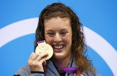 Allison Schmitt of the U.S. poses with her gold medal after winning the women's 200m freestyle final with an Olympic record during the London 2012 Olympic Games at the Aquatics Centre July 31, 2012.