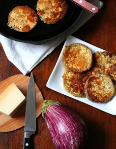 Garlic Parmesan Fried Eggplant - Low Carb and Gluten-Free  This is the recipe that won 2 of my 3 kids over to eating eggplant! Dipped in a mixture of almond flour, garlic and parmesan, these fried eggplant slices are sure to please.