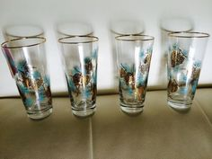 Mam-Maw also used these for her sweeeet iced tea on the rare occasions I remember her making it. She had a set of different sizes. I wonder if they were a prize from selling Stanley House Products. - Vintage Libbey Turquoise Gold Pine Cone Drinking Glasses Tall Mid Century Mint ebay $42.00