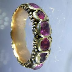 Late seventeenth century gold and rubies ring. The rubies are backed and foiled. Some of the rubies are in chipped condition but not more than expected from a ring of this age. Probably Italian ca 1680