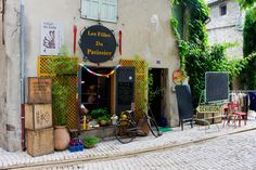 Far away from the beaten path in Saint-Rémy-de-Provence. Quite apart from the unusual assortment of objects lying outside, the striking name, which literally translates into English as 'the daughters of the pastrycook'. by snunney