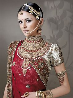 Indian bridal jewellery inspired by the movie Jodha Akbar. Love the hair accessory, nose ring and statement necklace.