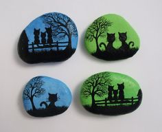 Hand painted stone magnets with Cats: Original art painting on pebbles The pebbles are painted with watercolour (background) and black ink and sprayed with varnish. Approximate size: One cat: 1.3x1.3 (3.3cmx3.3cm) Two cats: 1.8x1.4 (4.5cmx3.5cm) Three cats: 2x1.5 (5cmx3.8cm)  I custom paint on stones and shells and can paint something special for you in silhouette style: a special picture, word, name, initials, date, phrase....  More painted stones: https://www.etsy.com/uk/...