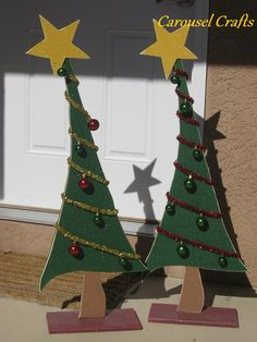 Tall standing wood craft Christmas tree with tinsel and lights