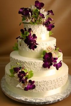 This is so pretty!  Love the contrast of the purple Dendrobium orchids and he white wedding cake! #purpleweddingcakes #chocolateweddingcakes