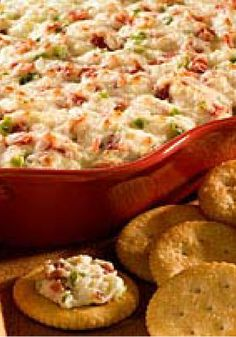 Baked Pepperoni Pizza Spread — Add chopped pepperoni and peppers to cream cheese and mozzarella to make this awesome baked appetizer spread. If they like pizza—they'll like this recipe!