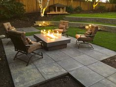 This space efficient modern backyard fire pit entertainment area is built upon Mutual Matereals 24 x 24 Glacier Slate Architectural Slabs - Charcoal Fire Pit Area, Diy Fire Pit, Fire Pit Backyard, Backyard Patio, Backyard Landscaping, Backyard Seating, Fire Pit On Pavers, Fire Pit On Concrete Slab, Backyard Ideas