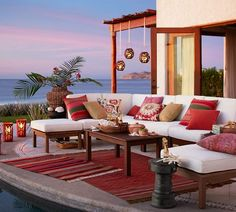 Create a comfortable outdoor patio with cushions and rugs. More on www.easyDIY.co.za