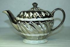 Silver lustre teapot by Sadler.