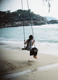 You have no idea what I would give to live on the beach with a swing exactly like this ♥