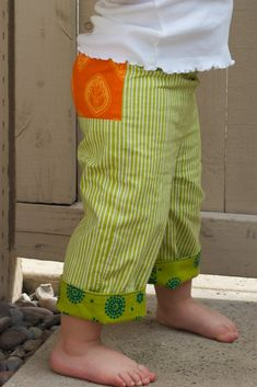 cuffs and pocket (or panel) like this on other pant pattern would be cute :) The cuff could just be a contrasting fabric sewn on the inside about 4 inches. Wear the folded up to start with, and fold them down as child gets taller. PERFECT FOR MY TODDLER WHO SEEMS TO GROW UP BUT NOT OUT!