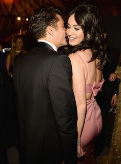 """Katy Perry and Orlando Bloom seem to like each other, don't ya think?  """"This Is How We Do"""" a flirty night at the Golden Globes!  Katy Perry turned heads on the red carpet Sunday night with her low-cut, figure-hugging cotton candy pink dress and bump-it — and all eyes were on her at the afterparties as"""