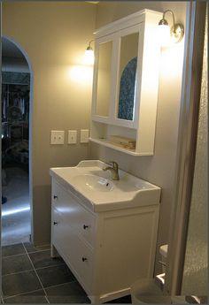 IKEA Bathroom Vanity + mirror with gray tile floor
