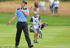 Battling on: Willett, pictured holding his shoulder, missed Wednesday's pro-am because of a neck problem