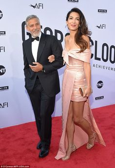 Amal Clooney locks lips with husband George Clooney as he bags Lifetime Achievement Award from American Film Institute (Photos) Amal Clooney, George Clooney, Peplum Dress, Strapless Dress, Human Rights Lawyer, Lifetime Achievement Award, Film Institute, Best Husband, In Hollywood