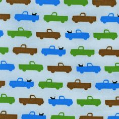 This blue trucks & dogs fabric will look adorable in your little boy's room!