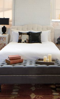 Great composition with the dark seating in the front of a light colored bed and headboard