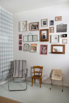 Wonderfully arranged wall art adding colour to this converted garage into this beautiful open plan loft style apartment in Paris.The result is a wonderfully charming mix of of re purposed flea market finds alongside mid century classic pieces.