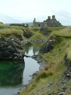 Flooded quarry and ruined cottages on Belnahua, Scotland