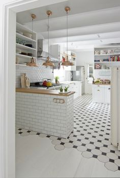 white kitchen with copper lights
