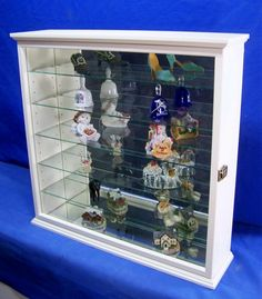 This beautiful antique white wall curio cabinet features a hinged glass door, adjustable glass shelves and brass door catch. Wall Curio Cabinet, Antique White Paints, Ogee Edge, Wood Cabinets, Curio Cabinets, Cabinet Dimensions, Wall Boxes, Table Top Display, Cabinet Furniture