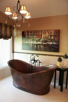 I adore this tub and the warm colors of the room