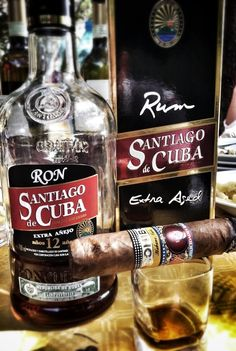 Ron Santiago de Cuba Añejo, made in the cradle of rum, recognized as such since Through rums like this, you get to prove that it can be a soft and light drink with which to enjoy. Cigars And Whiskey, Good Cigars, Pipes And Cigars, Whiskey Bottle, Cigar Club, Cigar Bar, Cigar Accessories, Ron, Fine Wine