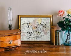 The world is your oyster!    A vintage world map accents this hand-written modern calligraphy quote. Flourishes and decorations add a handcrafted