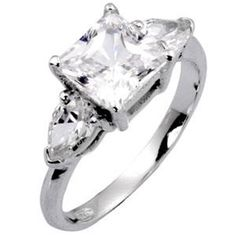 BABE! THIS IS MY FAVORITE JEWEL CUT AND SETTING! Princess cut center jewel with triangles on either side. If you just get an engagement ring, and not a set, this is what I like.